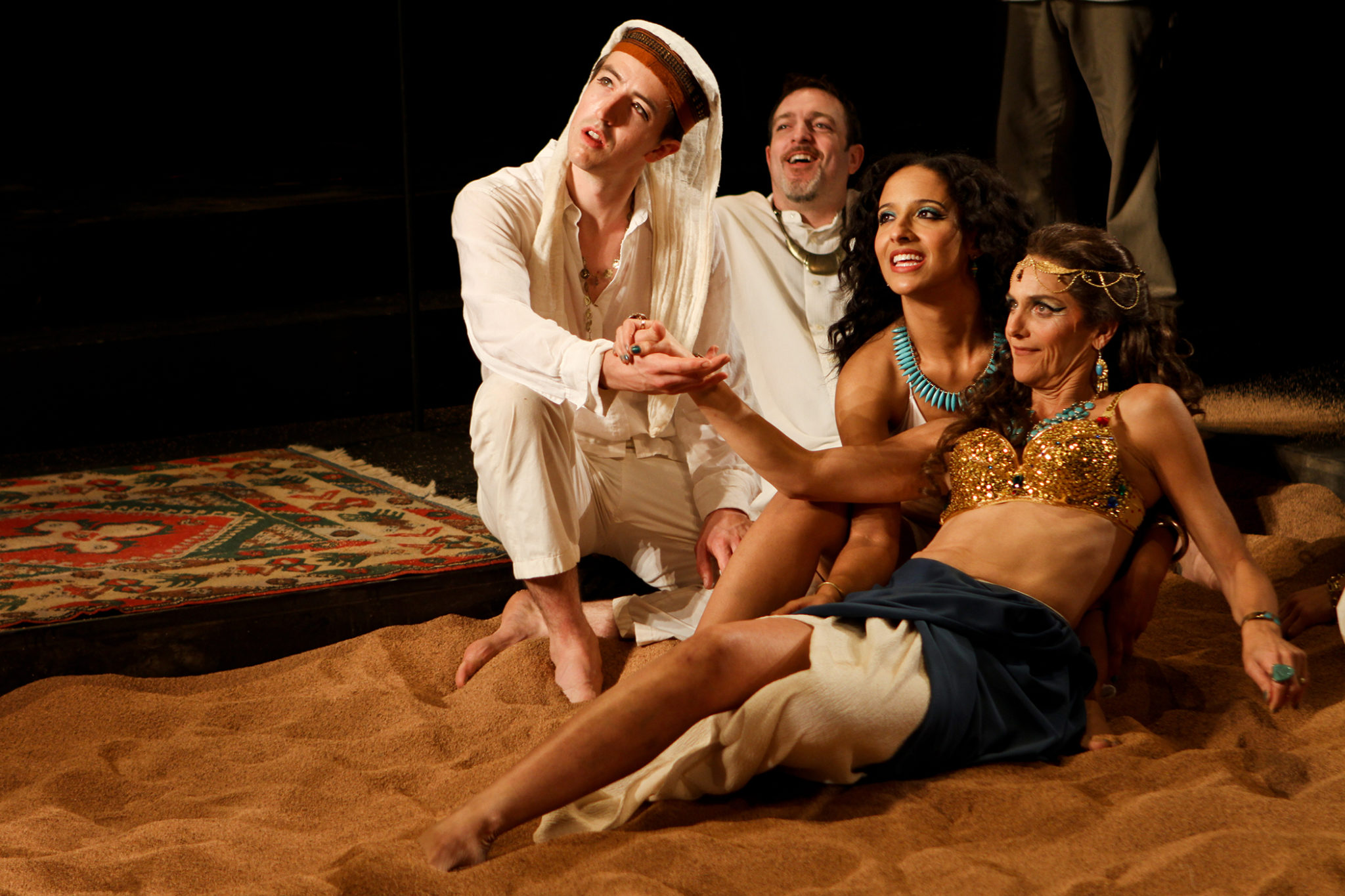 """Adam Standley as Alexas, Mike Dooly as ensemble, Allison Strickland as Iras and Amy Thone as Cleopatra in Seattle Shakespeare Company's 2012 production of """"Antony and Cleopatra."""" Photo by John Ulman."""