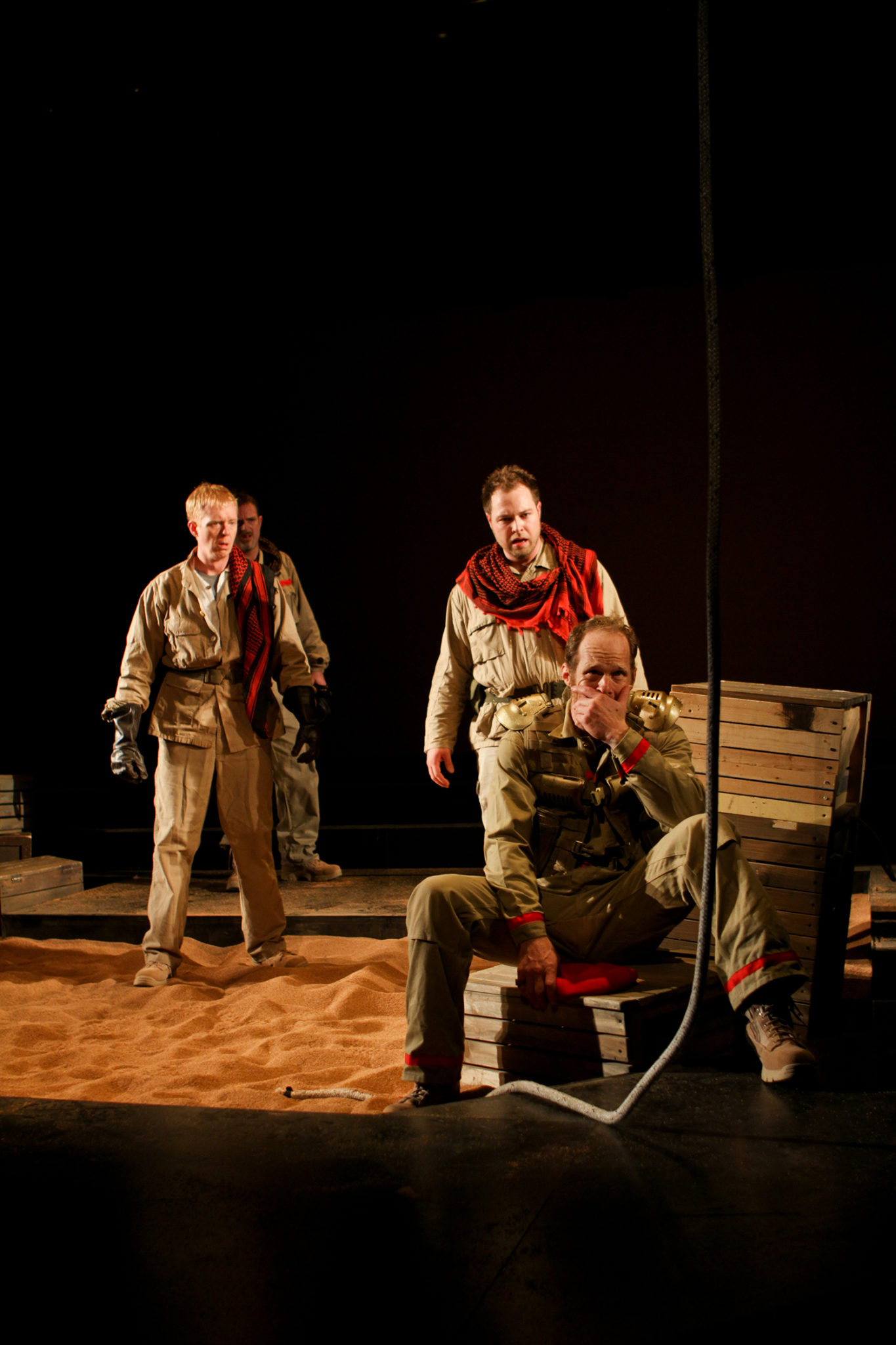 """Justin Alley as soldier, Alex Matthews as Eros, and Hans Altwies as Mark Antony in Seattle Shakespeare Company's 2012 production of """"Antony and Cleopatra."""" Photo by John Ulman."""