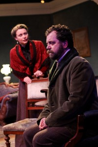 "Betsy Schwartz as Mrs. Linde and Peter Dylan O'Connor as Krogstad in Seattle Shakespeare Company's 2013 production of ""A Doll's House."" Photo by John Ulman."