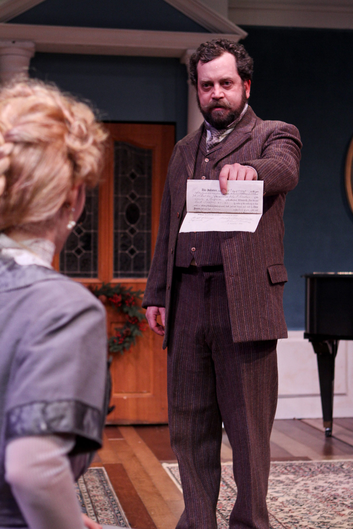 "Jennifer Sue Johnson as Nora and Peter Dylan O'Connor as Krogstad in Seattle Shakespeare Company's 2013 production of ""A Doll's House."" Photo by John Ulman."