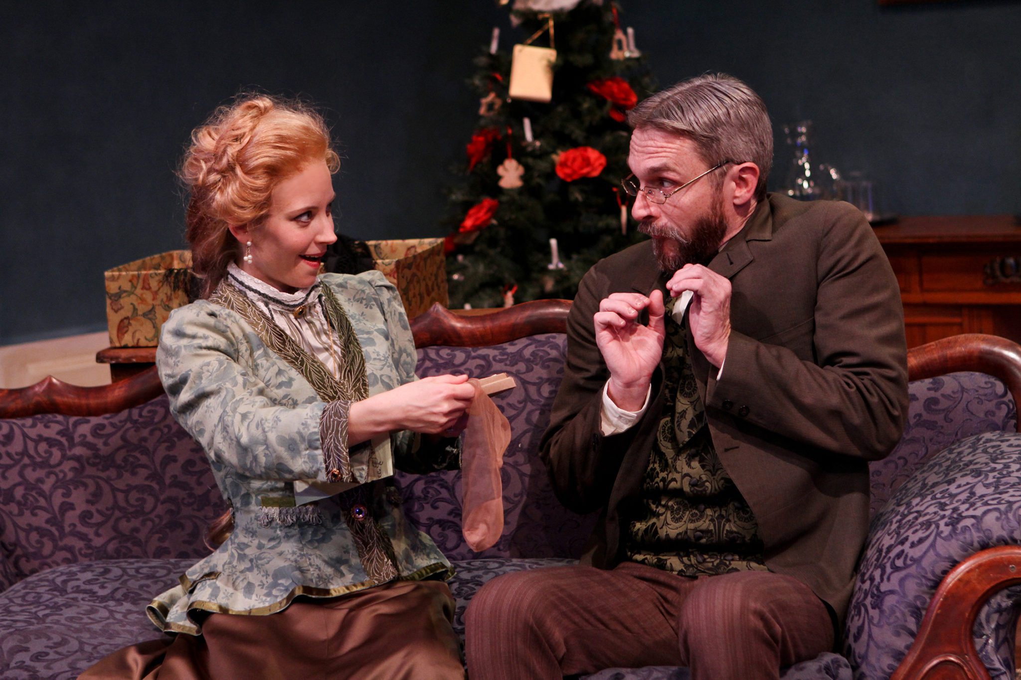 "Jennifer Sue Johnson as Nora and George Mount as Dr. Rank in Seattle Shakespeare Company's 2013 production of ""A Doll's House."" Photo by John Ulman."