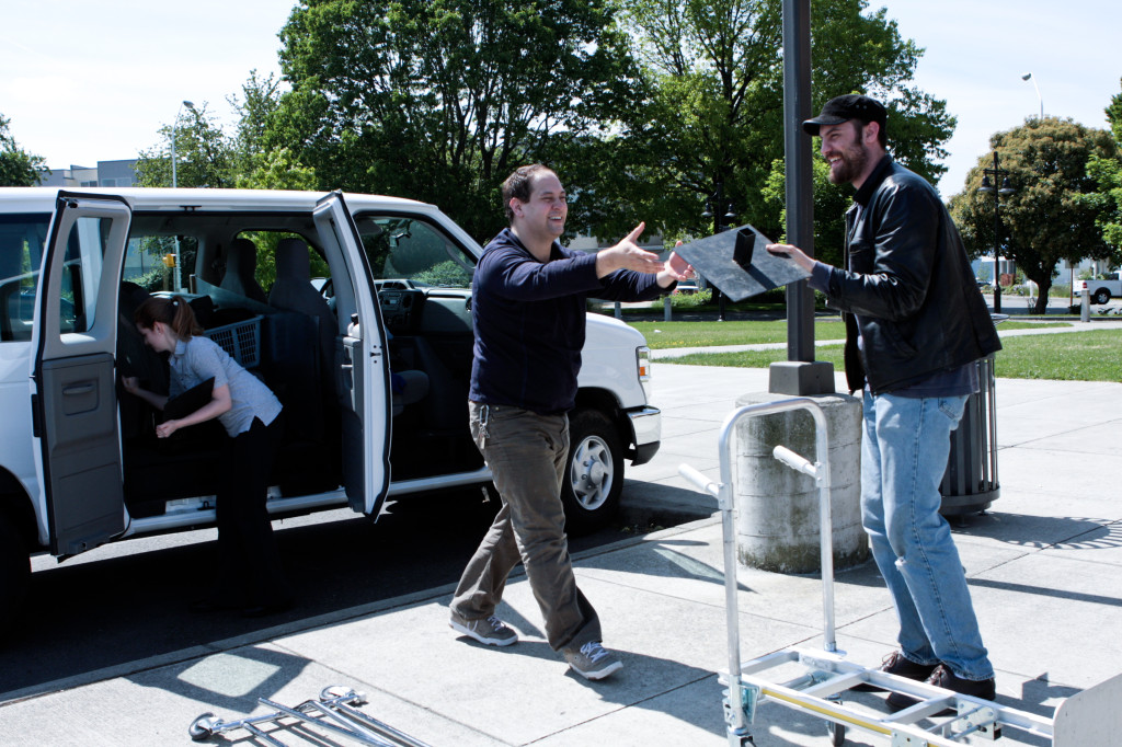 "Cast members from Seattle Shakespeare Company's 2009 tour of ""Othello"" loading up the van to hit the road."