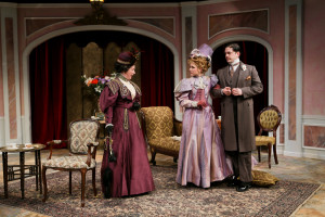 "Kimberly King, Emily Grogan, and Connor Toms in Seattle Shakespeare Company's 2014 production of ""The Importance of Being Earnest."" Photo by John Ulman."